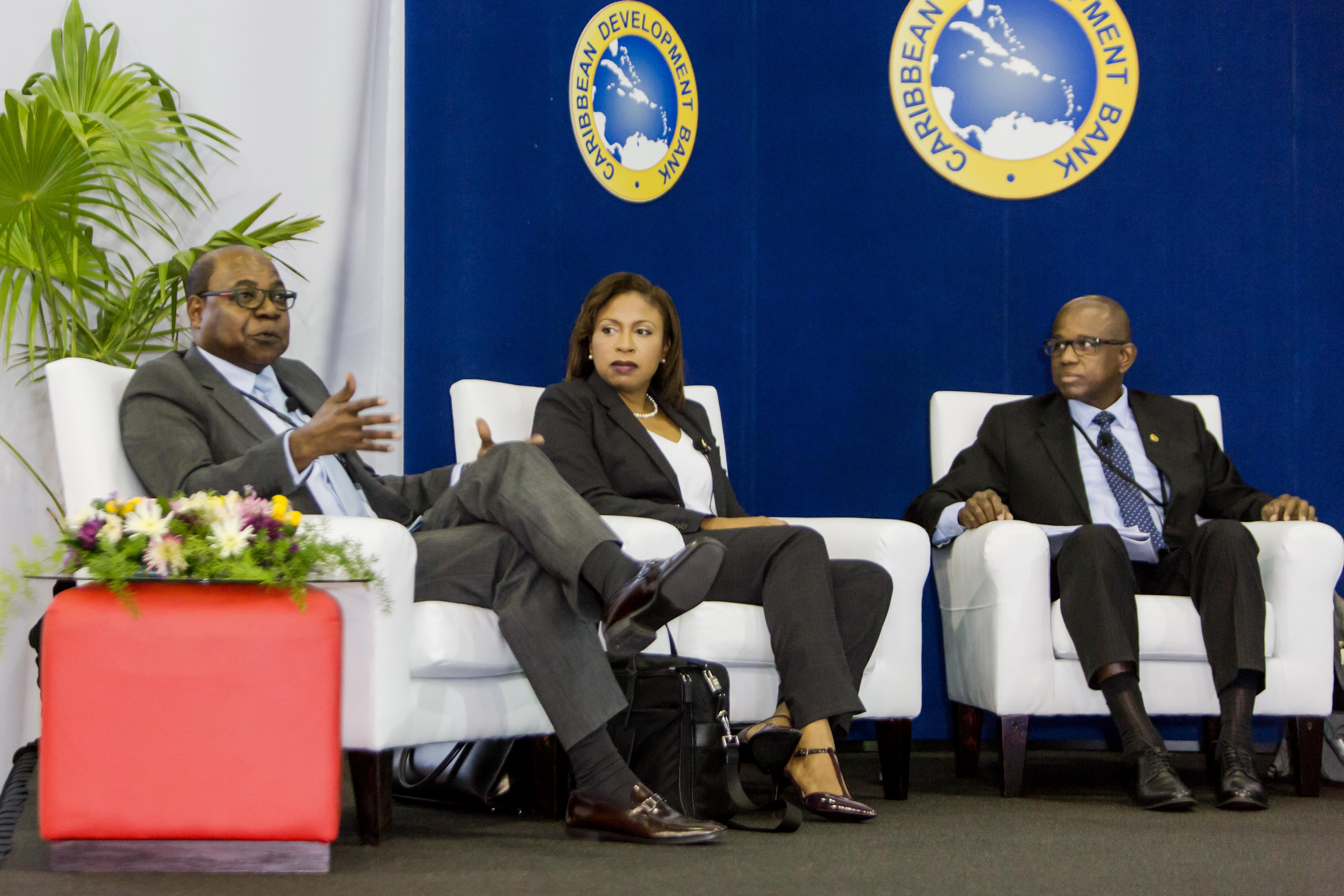 (L-R) Honourable Edmund Bartlett, Minister of Tourism, Government of Jamaica makes a point during the seminar, while Stacy Cox, Executive Director, Turks and Caicos Hotel and Tourism Association and Hugh Riley, Secretary General and Chief Executive Officer, Caribbean Tourism Organisation look on.