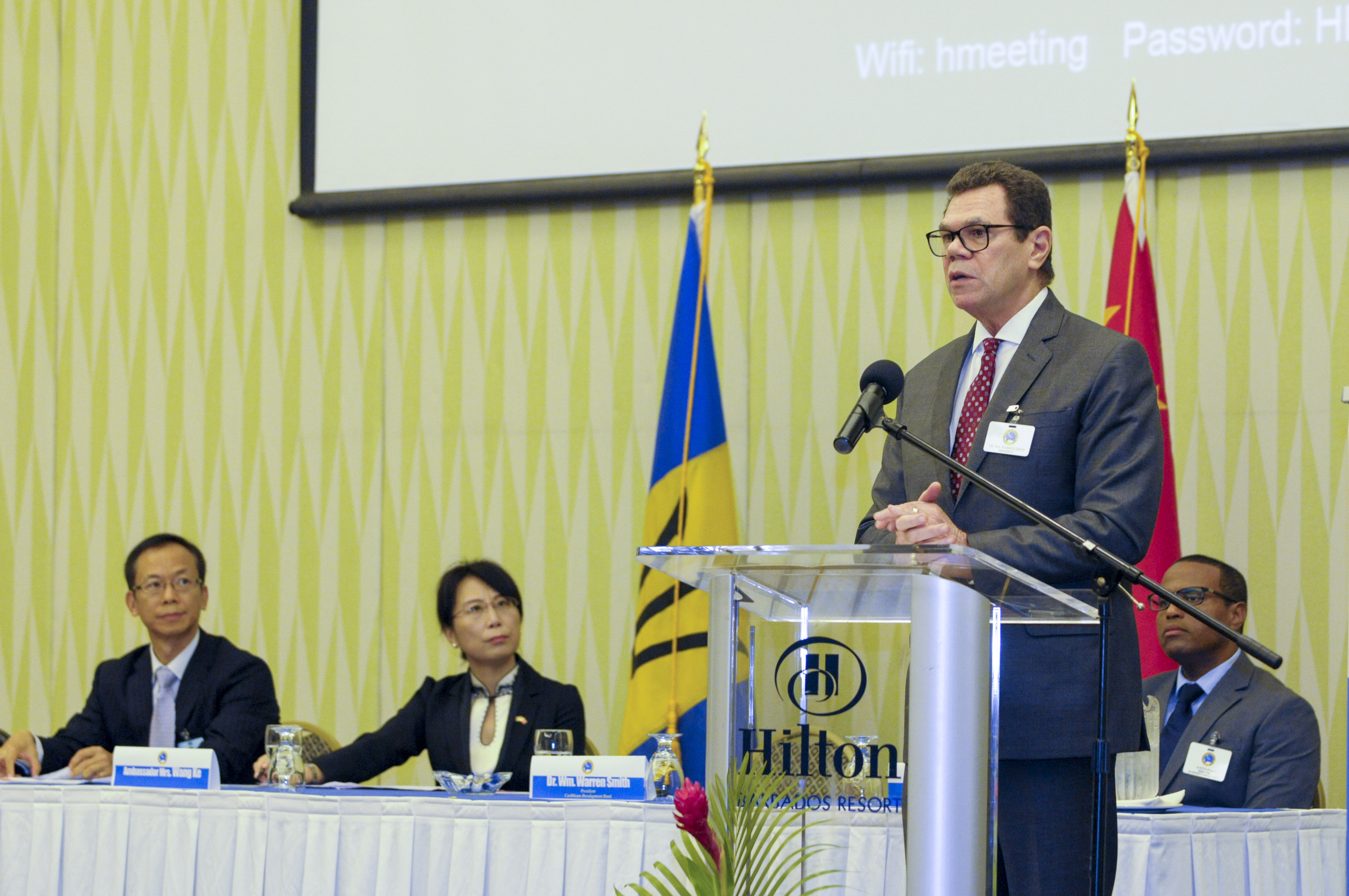 Dr. Warren Smith, President, CDB, speaking at the opening ceremony on July 10, 2017. Looking on are (L-R) Dr. Wen Xinxiang, Secretary General, Monetary Policy Committee, Director General, Monetary Policy Department, People's Bank of China; Ambassador of the People's Republic of China to Barbados, H.E. Wang Ke and Dr. Justin Ram, Director, Economics, CDB.
