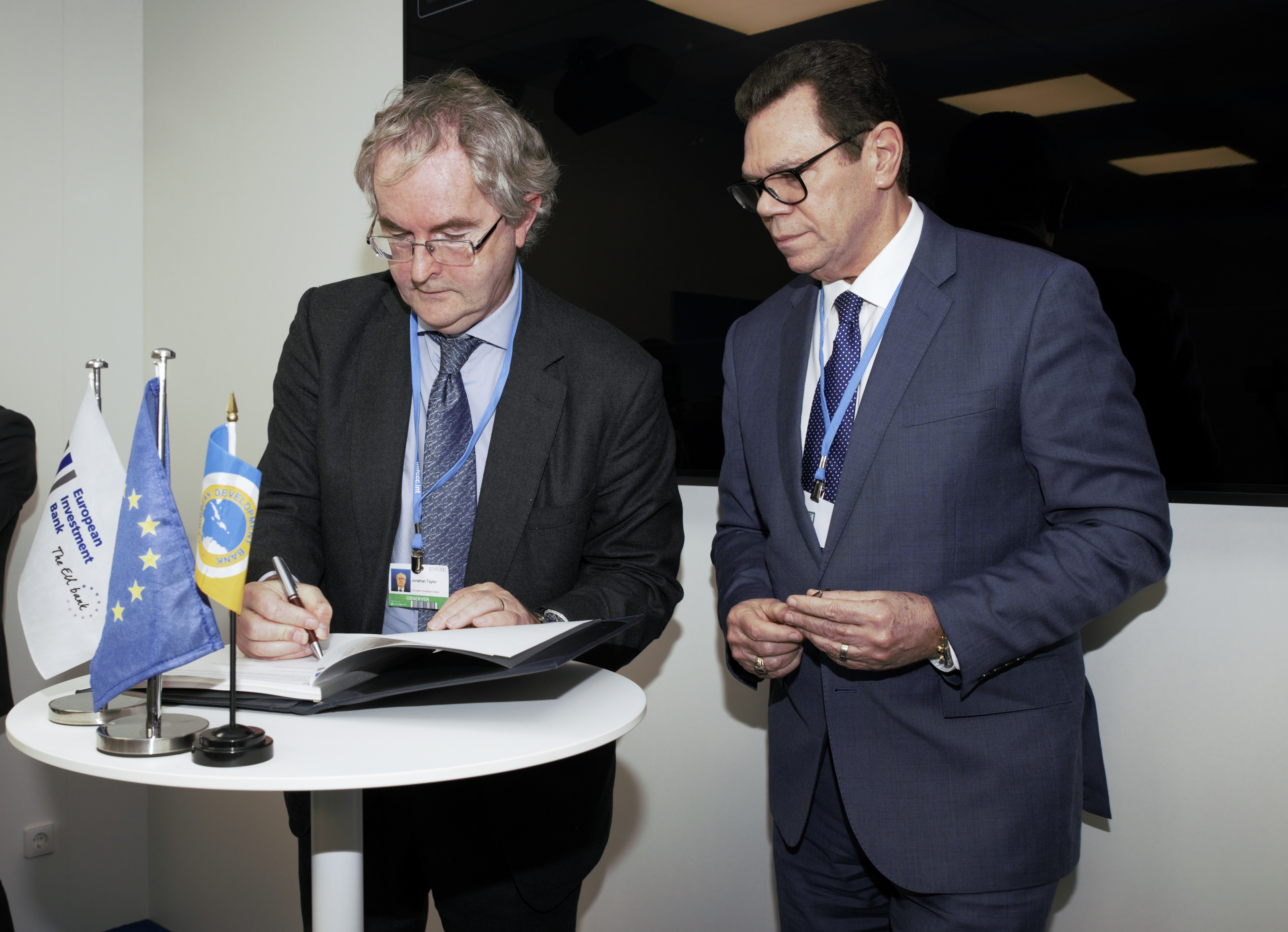 EIB Vice President responsible for Climate Action, Jonathan Taylor (left) and CDB President, Dr. Wm. Warren Smith (right) sign the agreement in Bonn on November 13, 2017