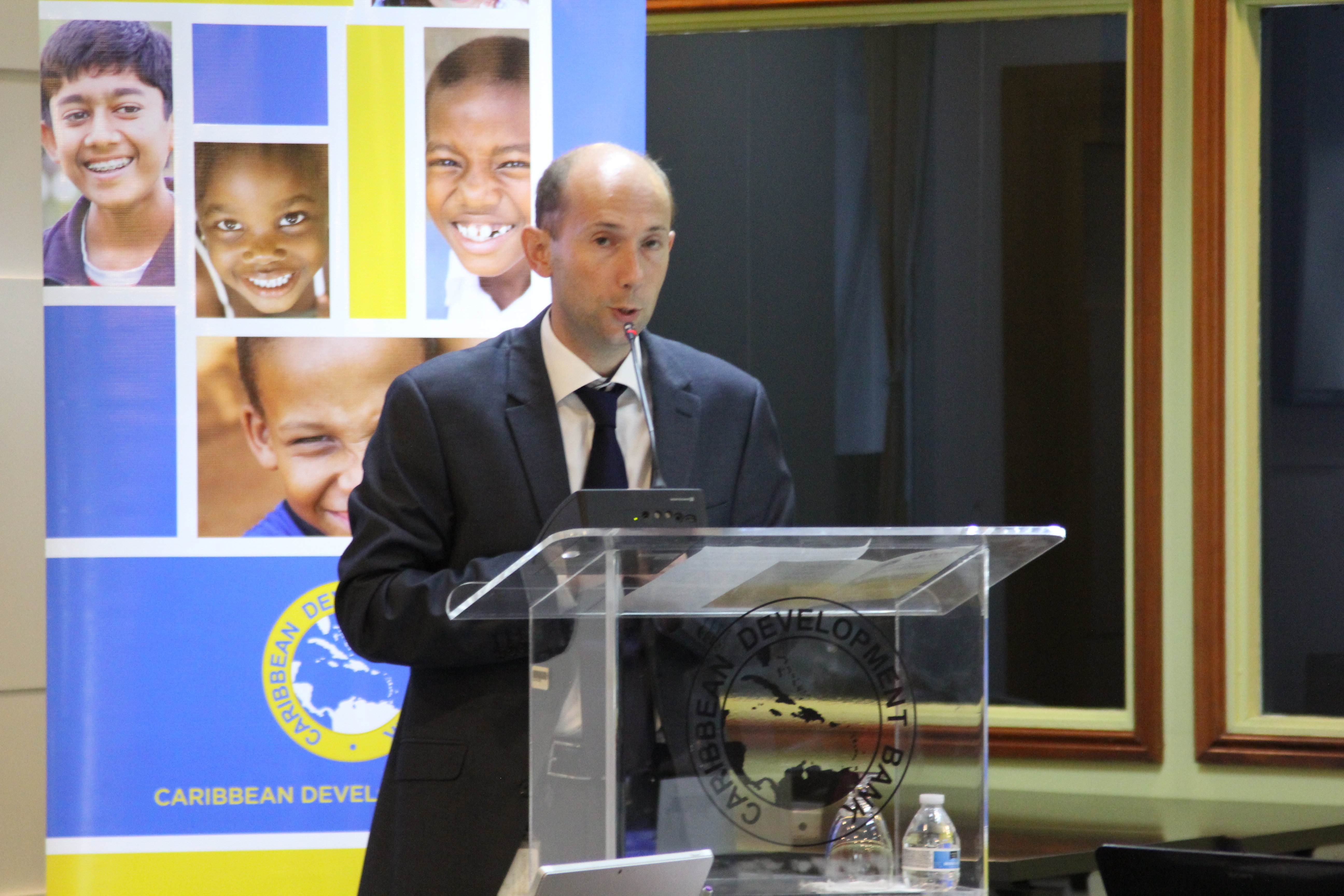 Douglas Fraser, Head, Procurement, CDB, delivers remarks during the opening session of the meeting.