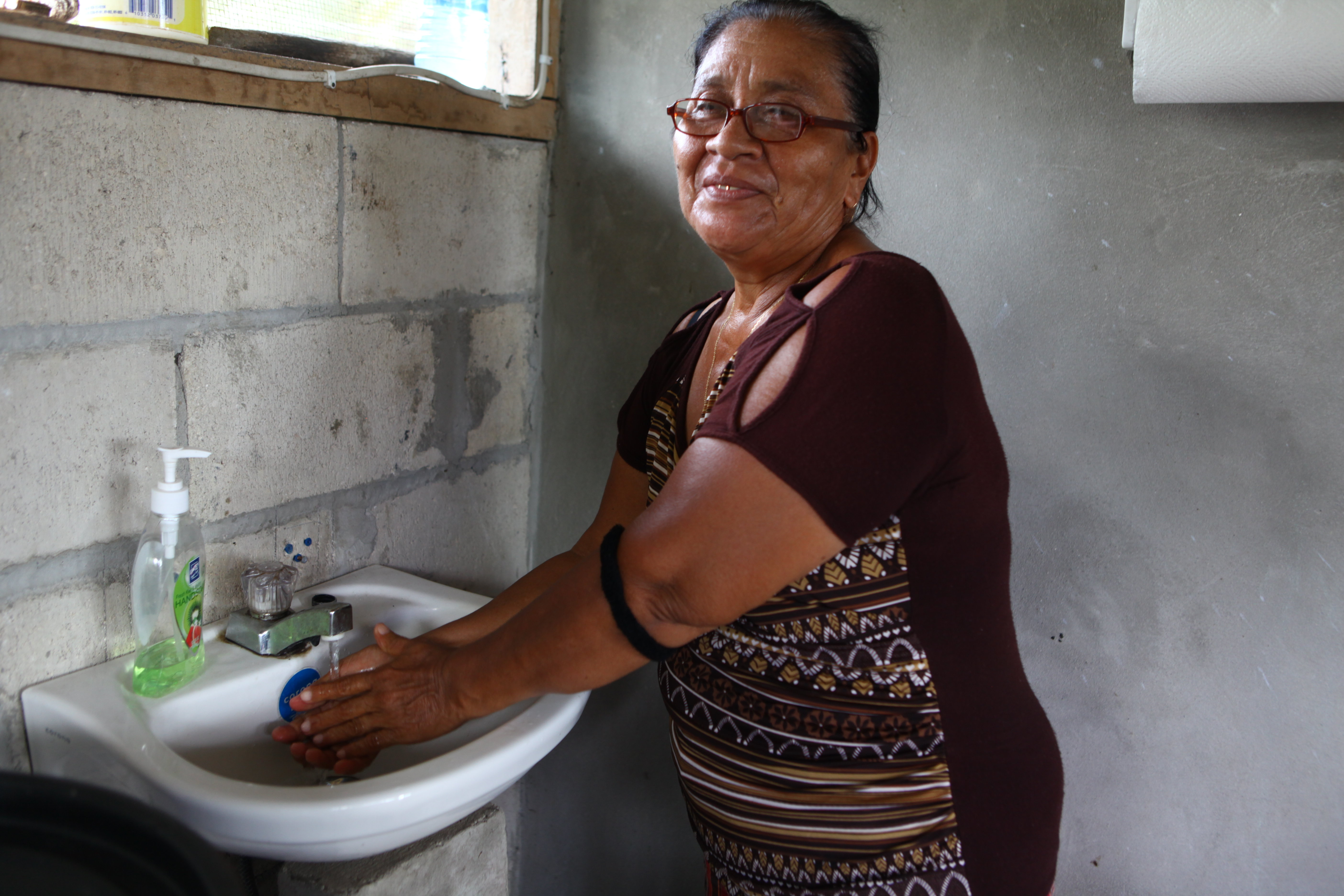 Juanita Banner washes her hands at home