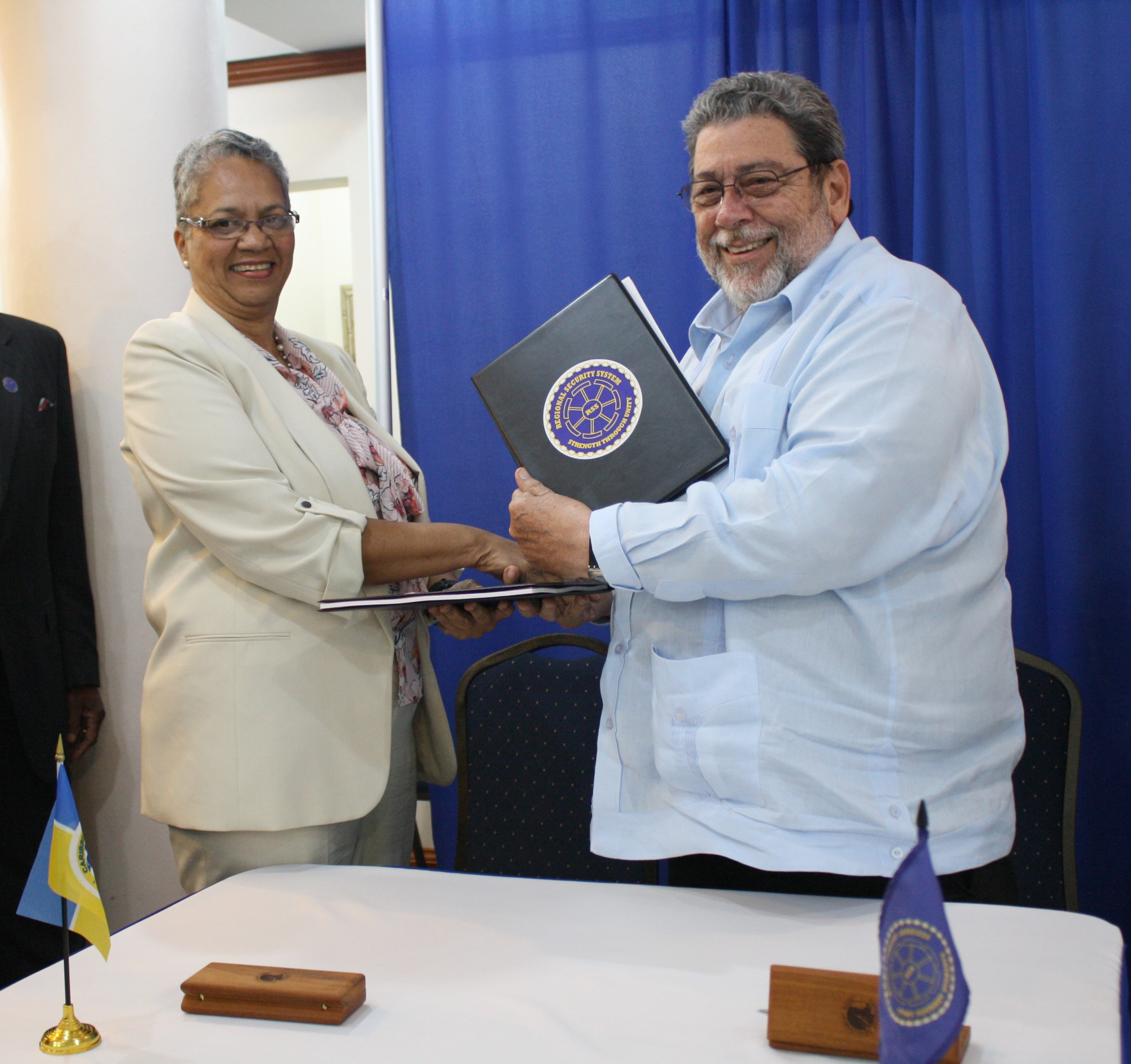 CDB Vice-President Monica La Bennett and RSS Chairman, St. Vincent and the Grenadines Prime Minister Dr. Ralph Gonsalves smiling facing camera.