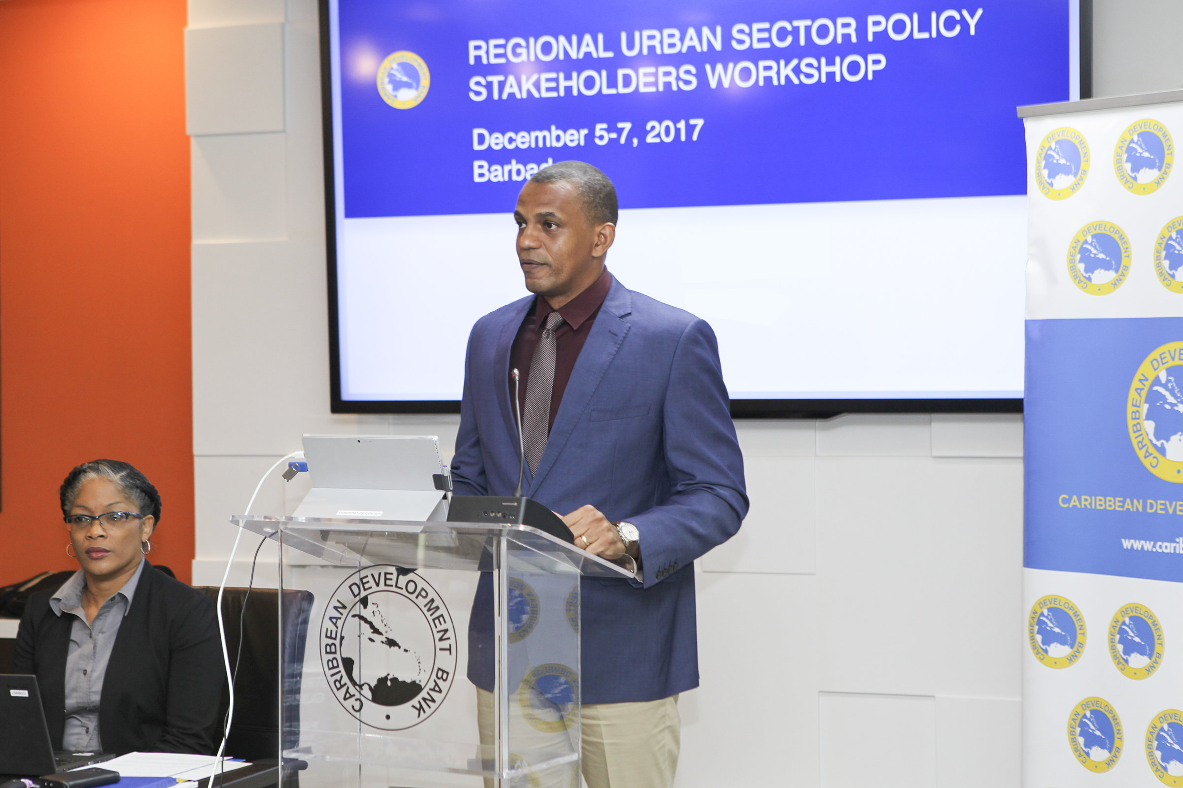 Daniel Best, Director of Projects, CDB, speaks at the opening of the Regional Urban Sector Policy Stakeholders Workshop on December 5, 2017. Looking on is Sharon Griffith, Operations Officer, CDB.