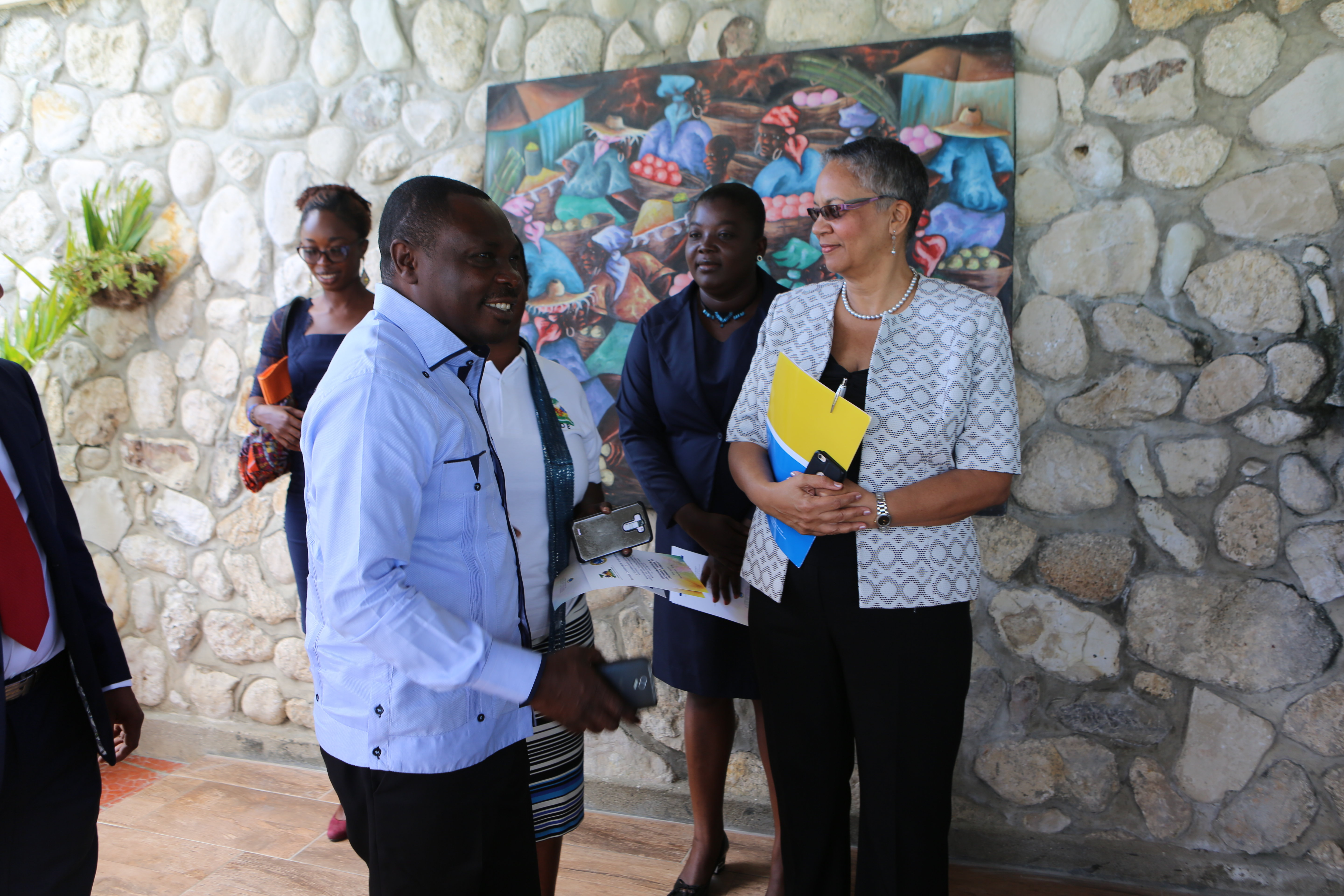 H.E. Pierre Simon Georges, Minister of Environment, Haiti (Left) and Monica La Bennett, Vice-President (Operations), CDB, discuss how the project will positively impact the lives of Ile-à-Vache's residents.