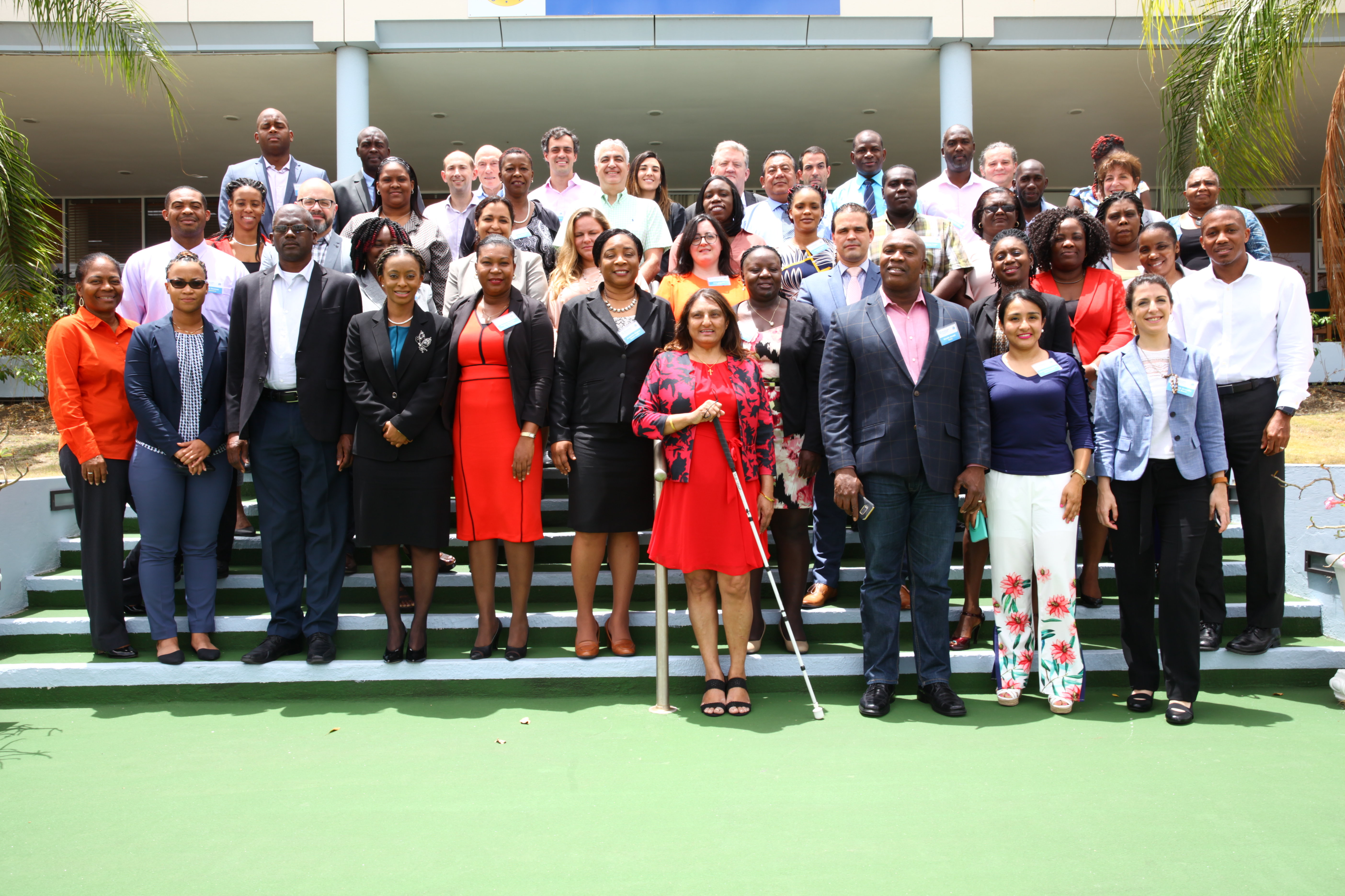 Participants of the Procurement in Emergency Situations Workshop gather for a group photo at the Caribbean Development Bank.