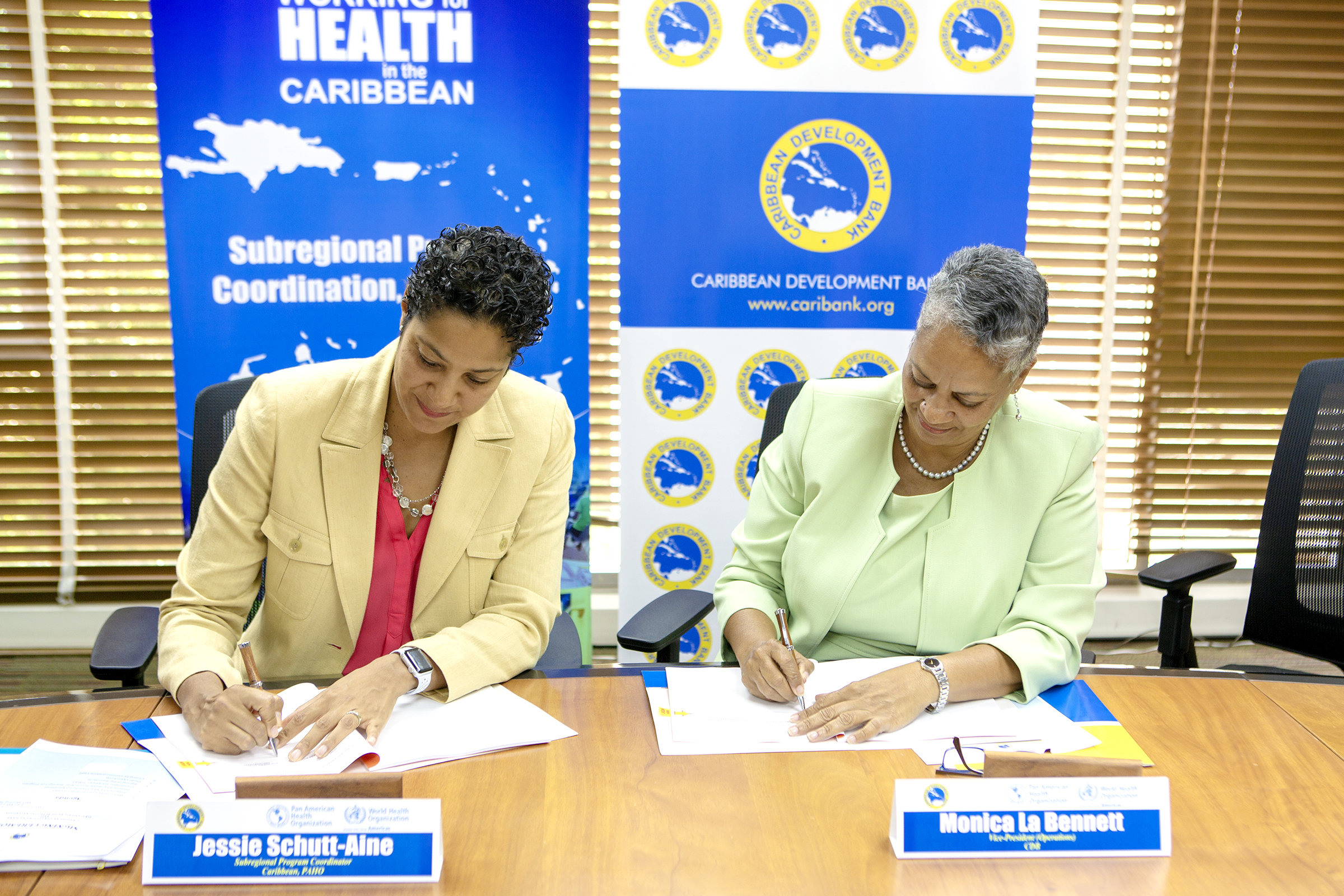 Jesse Schutt Aine (left), Subregional Program Coordinator, Caribbean, PAHO and Monica La Bennett (right), Vice-President (Operations), CDB, sign the agreement to enhance capacity for mental health and psychosocial support in disaster management in the Caribbean. The signing took place on June 13, 2018, at CDB's headquarters in Barbados.