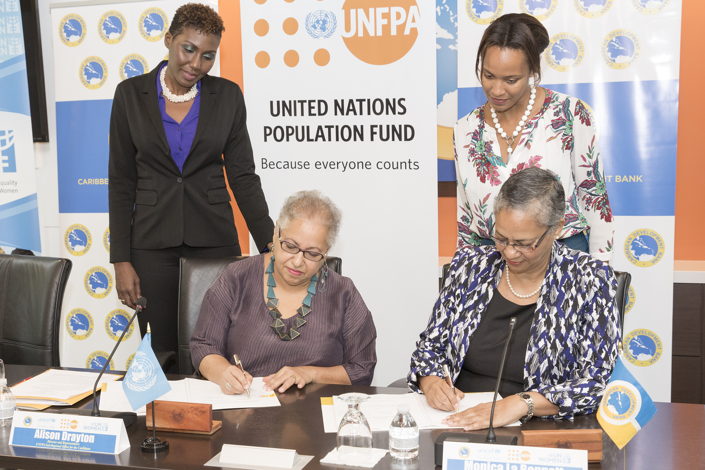 Alison Drayton, Director and Representative, UNFPA Sub-Regional Office for the Caribbean (left) and Monica La Bennett, Acting Vice-President (Operations), CDB (right).