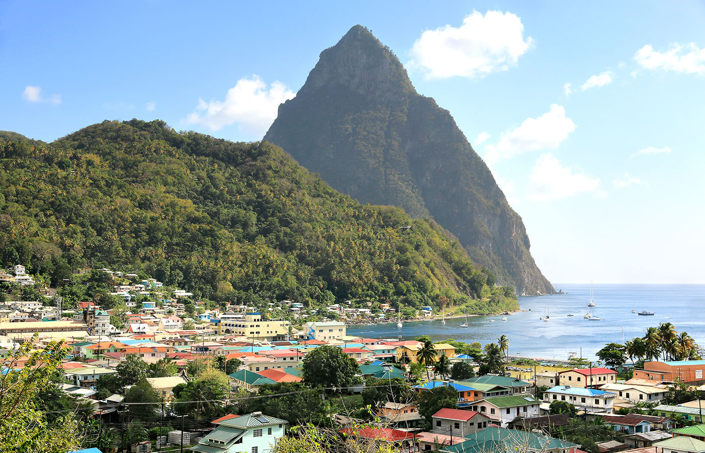 Aerial view of the small town Soufriere in Saint Lucia with The Pitons in the distance