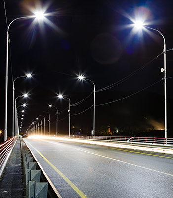Night image of a road on a bridge with LED lighting