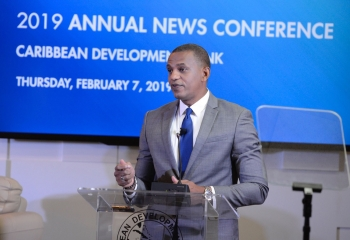 Daniel Best in a blue suit standing at the lectern delivering his remarks at the Annual News Conference