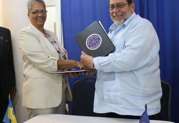 CDB Vice-President Monica La Bennett and Chairman of the RSS Council of Ministers, St. Vincent and the Grenadines Prime Minister, Hon. Dr. Ralph Gonsalves shake hands after signing the grant agreement between CDB and the RSS.
