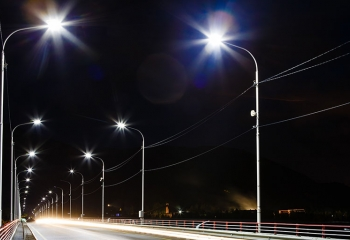 road way lit by energy efficient light-emitting diode (LED) street lights