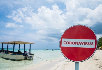 Coronavirus no-entry sign in front of a beach, Negril, Jamaica